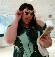 Amber, of Style Plus Curves, trying on some cool sunnies